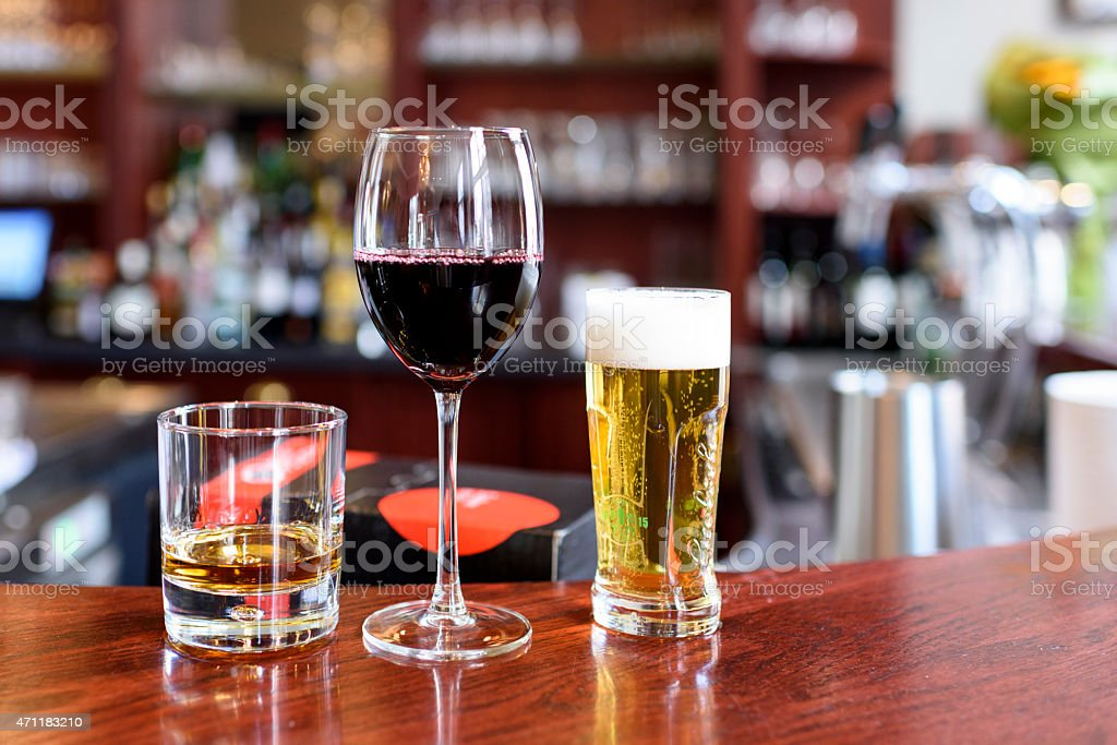 Alcohol drinks on a bar stock photo