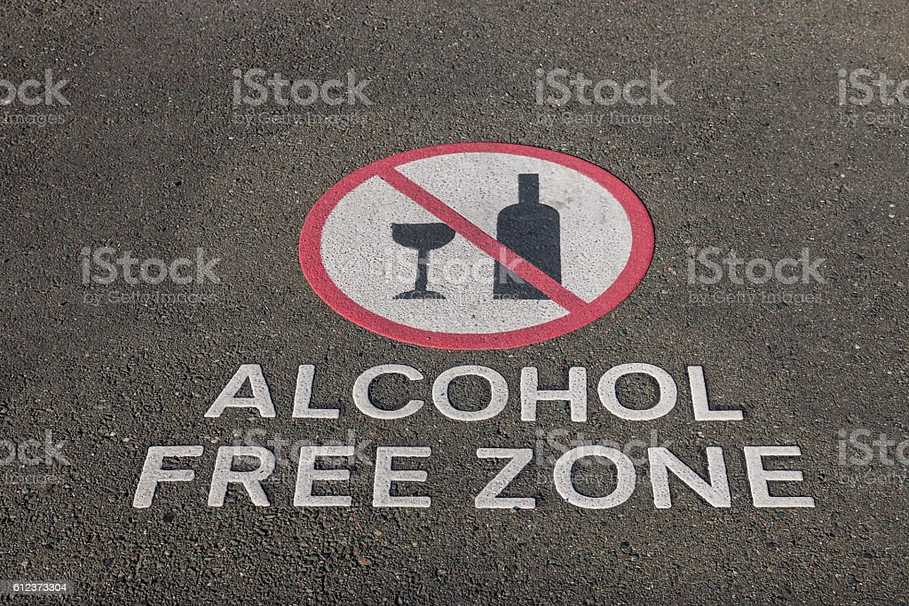 alcohol free zone sign on pavement stock photo