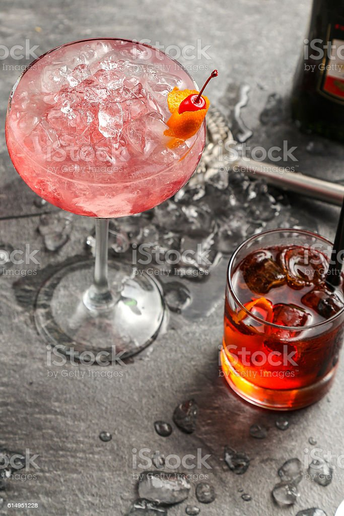 Alcohol in a glass on a dark wooden background stock photo