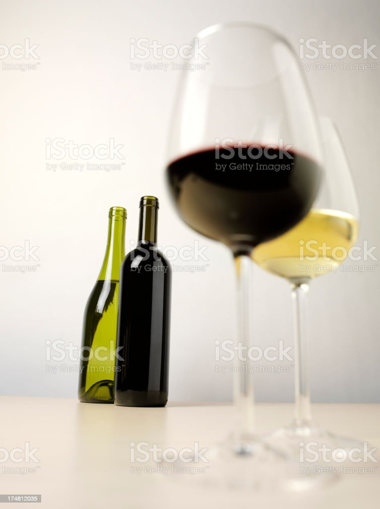 Alcohol in Glasses with Wine Bottles royalty-free stock photo
