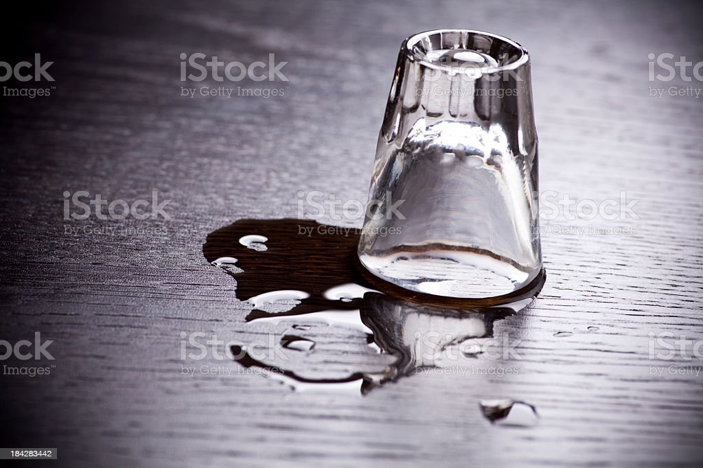 Alcohol shot cup upside down on table stock photo