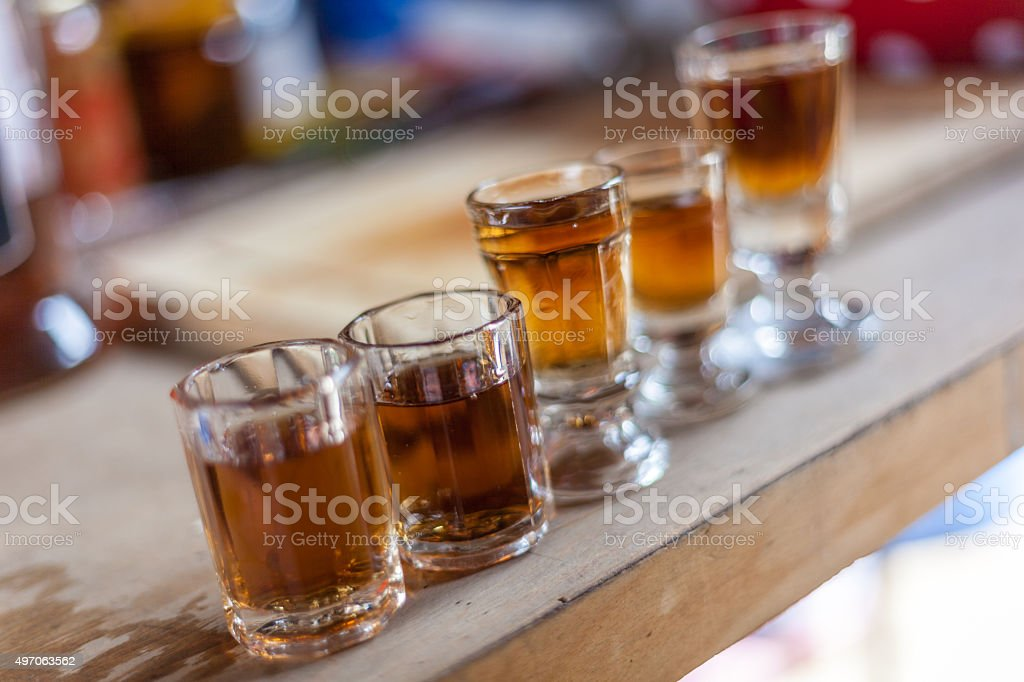 Alcohol shots in vintage shot glasses stock photo