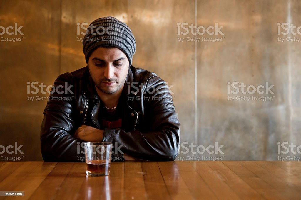 Alcoholic at the Bar stock photo