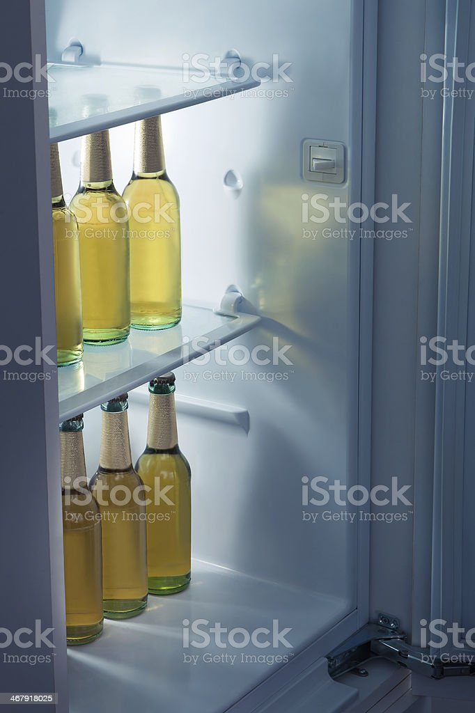 Alcoholic bottles arrange in refrigerator stock photo