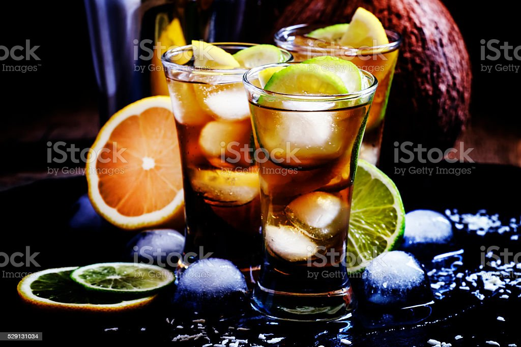 Alcoholic cocktail coconut cola, liqueur, lime, lemon and ice stock photo