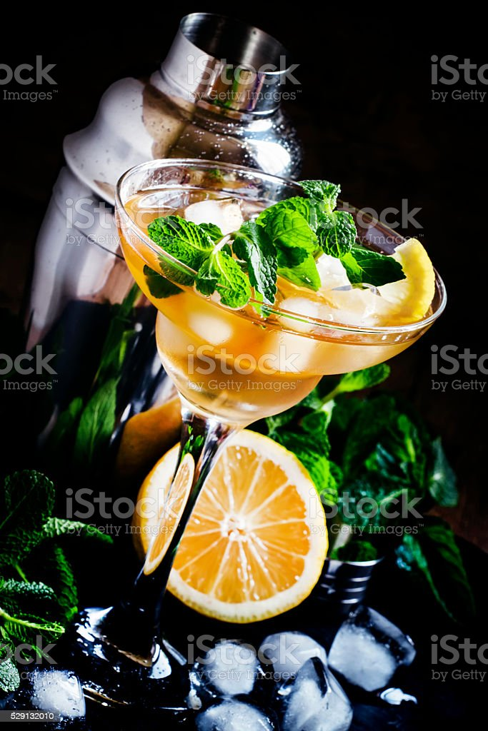 Alcoholic cocktail daiquiri with lemon and mint stock photo