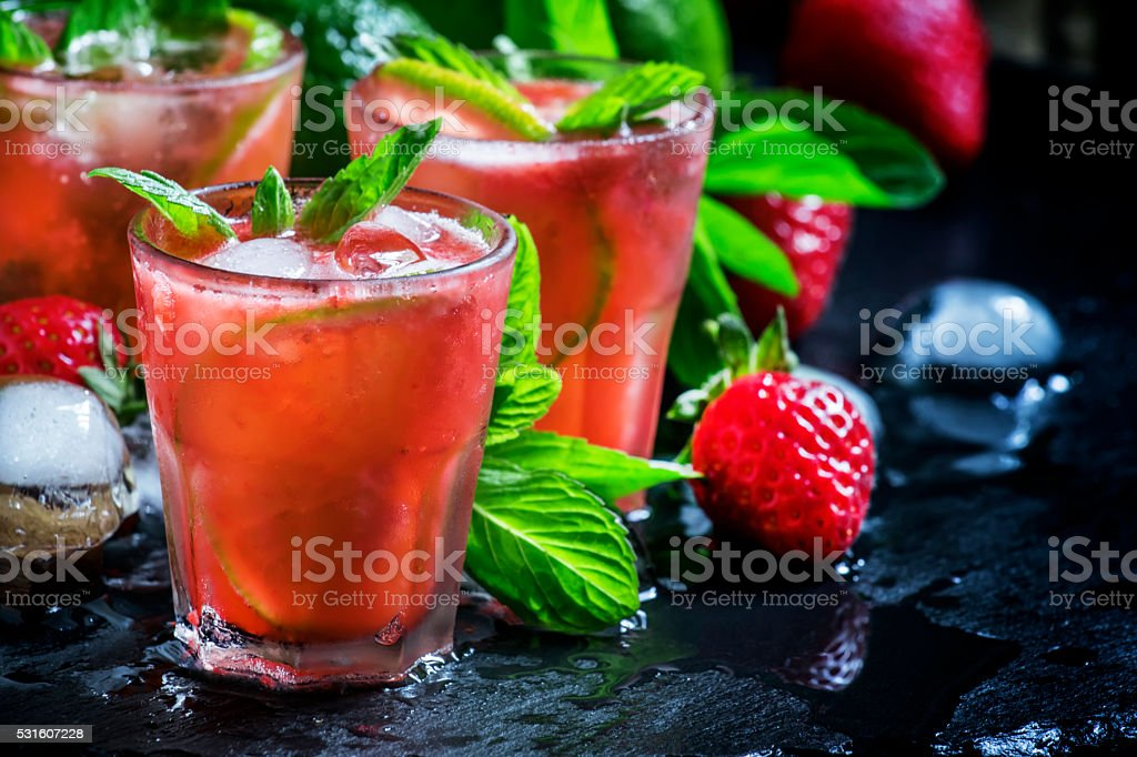 Alcoholic cocktail strawberry mojito with white rum stock photo