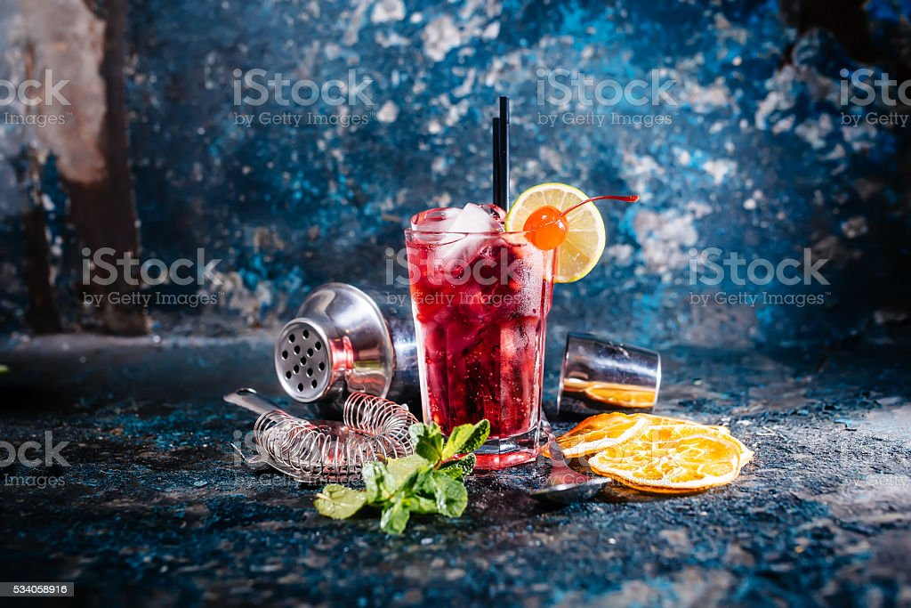alcoholic cocktail with lime and mint garnish stock photo