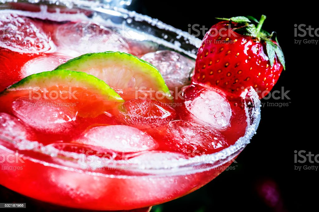 Alcoholic cocktail with strawberry stock photo