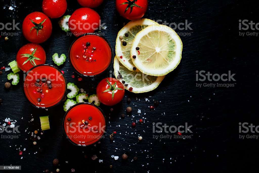 Alcoholic cocktail with tomato juice on dark background stock photo