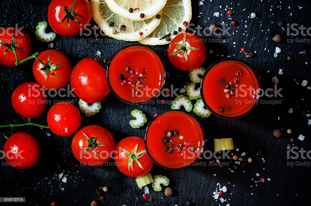 Alcoholic cocktail with tomato juice, vodka and spices stock photo