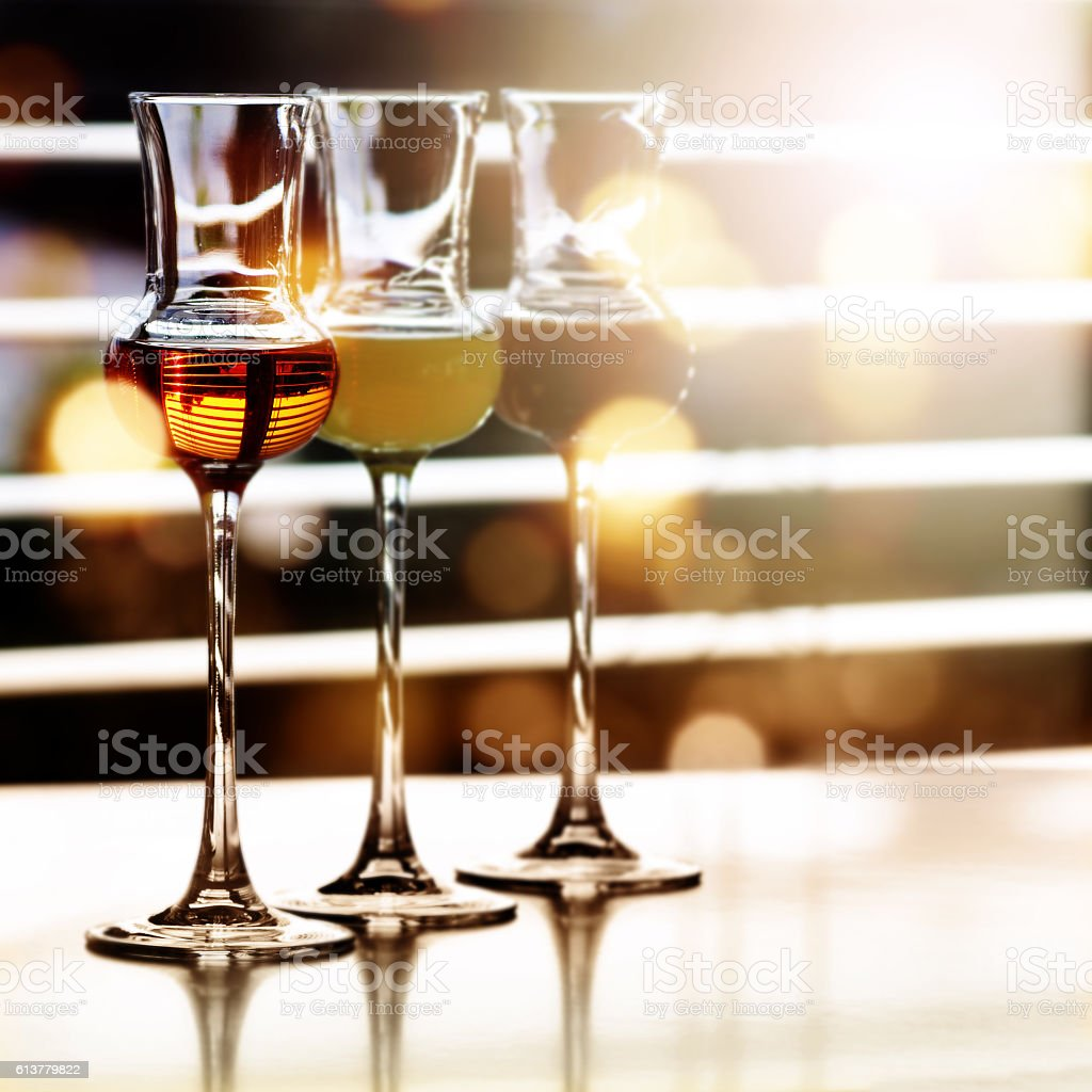 Alcoholic drinks in front of a window stock photo