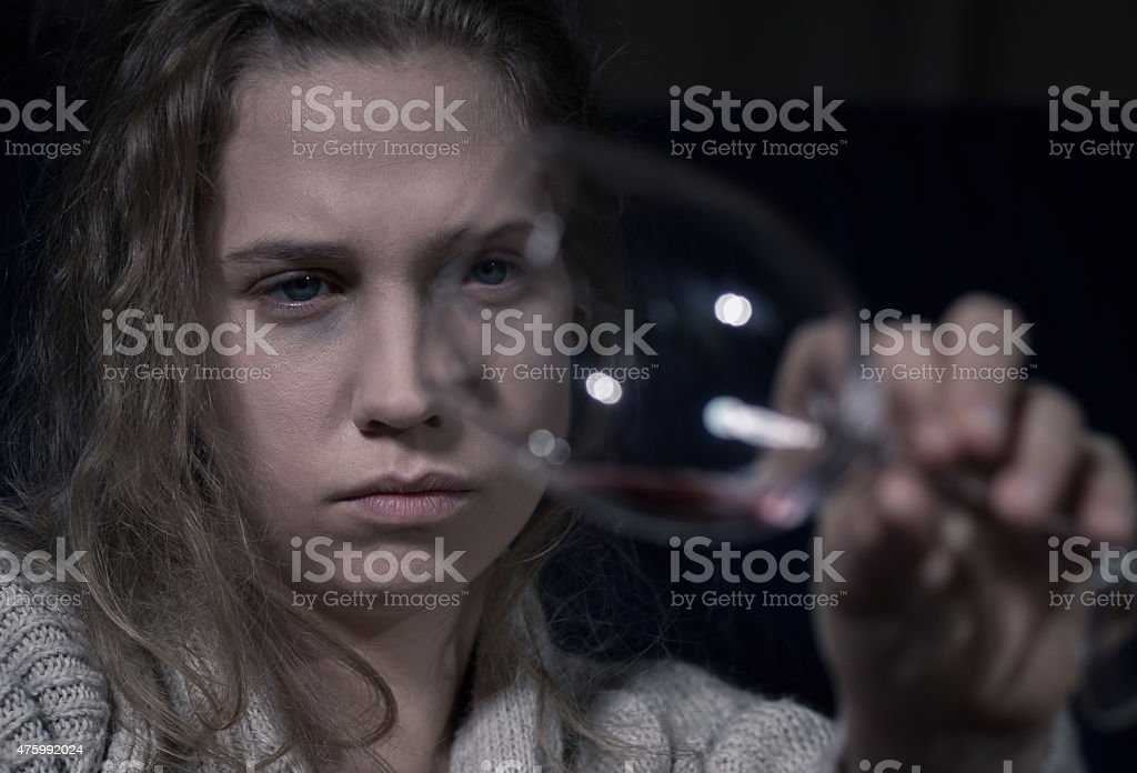 Alcoholic holding empty glass stock photo