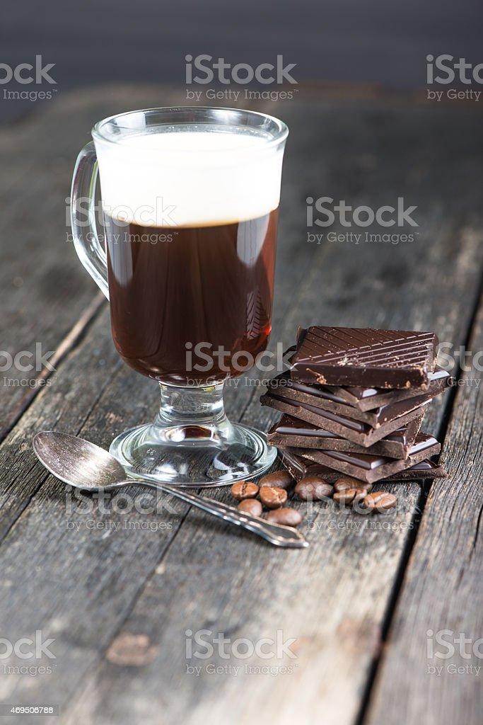 alcoholic irish coffee with dark chocolate and caffee beans stock photo