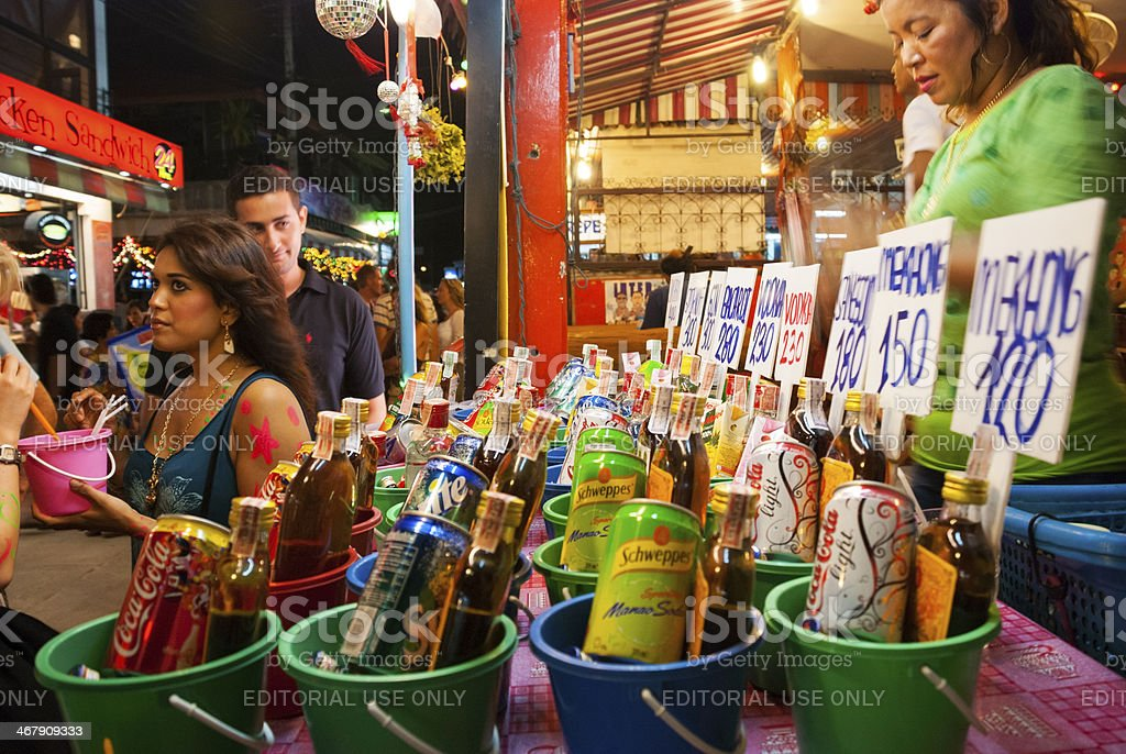 Alcoholic mixed-drink buckets for sale - Full Moon Party Thailand stock photo
