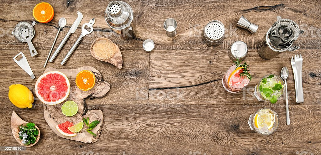 Alcoholic nonalcoholic drinks with ice Cocktail making tools stock photo