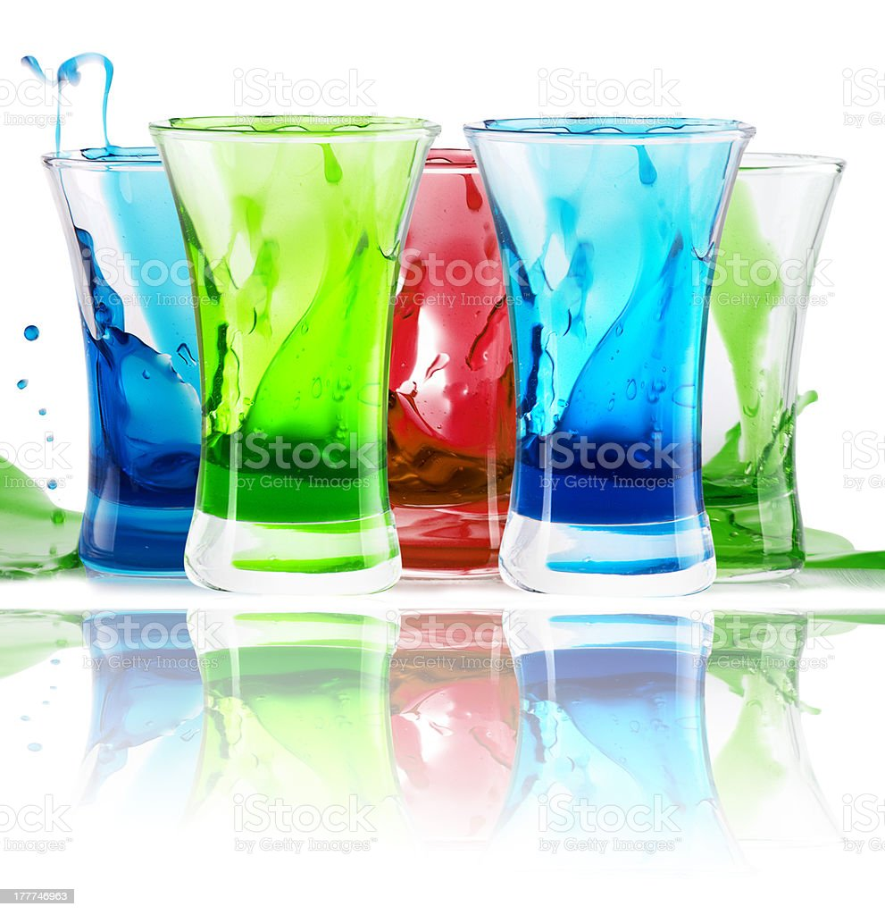 alcoholic  shot cocktails stack with splash royalty-free stock photo