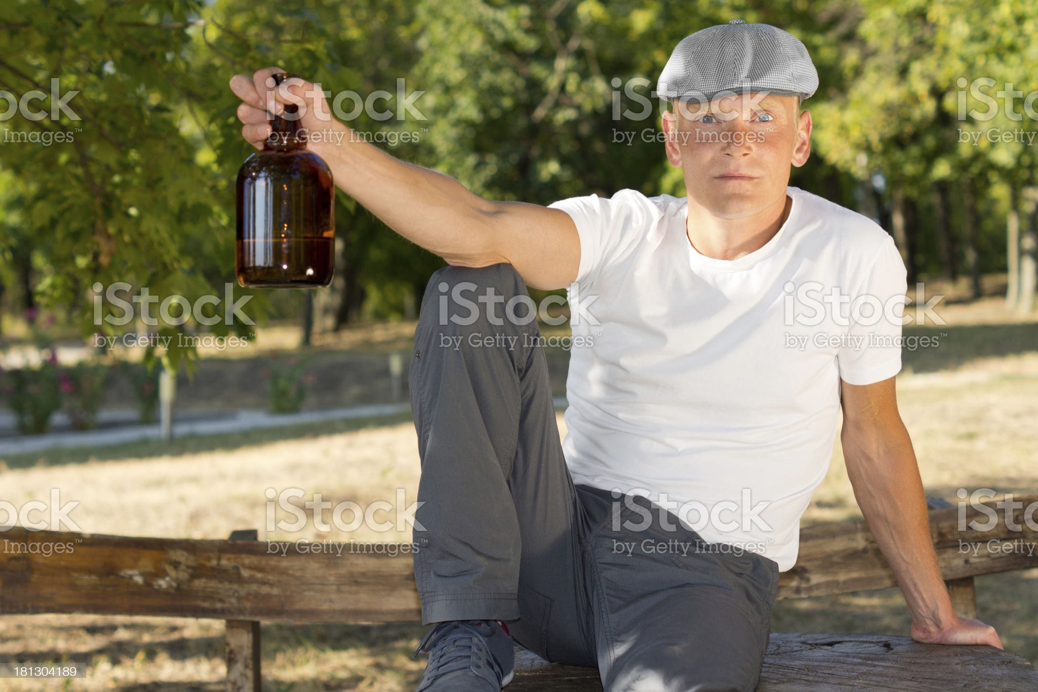 Alcoholic sitting alone in the park with a bottle royalty-free stock photo