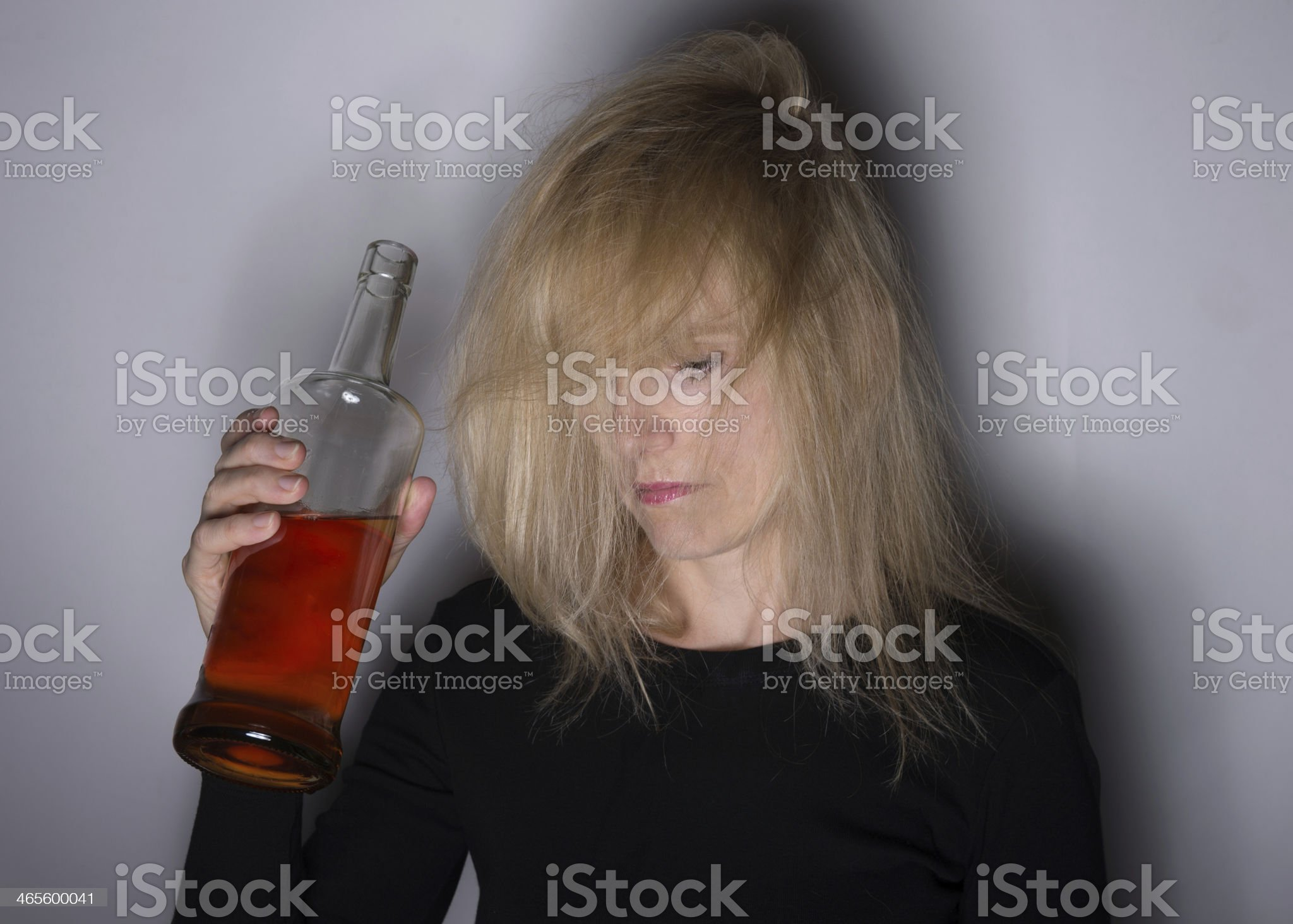 Alcoholic Woman Looks Down royalty-free stock photo