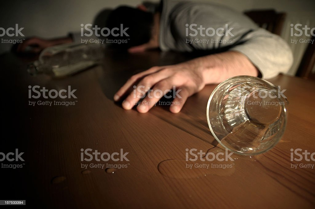 Alcoholism Concept Man Drunk Laying on the Table royalty-free stock photo