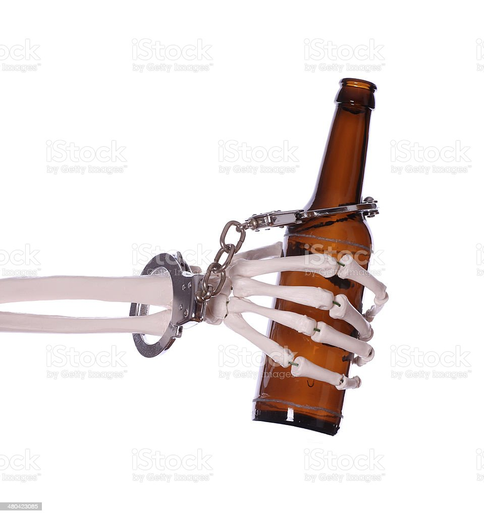 alcoholism to death with handcuff and bottle stock photo