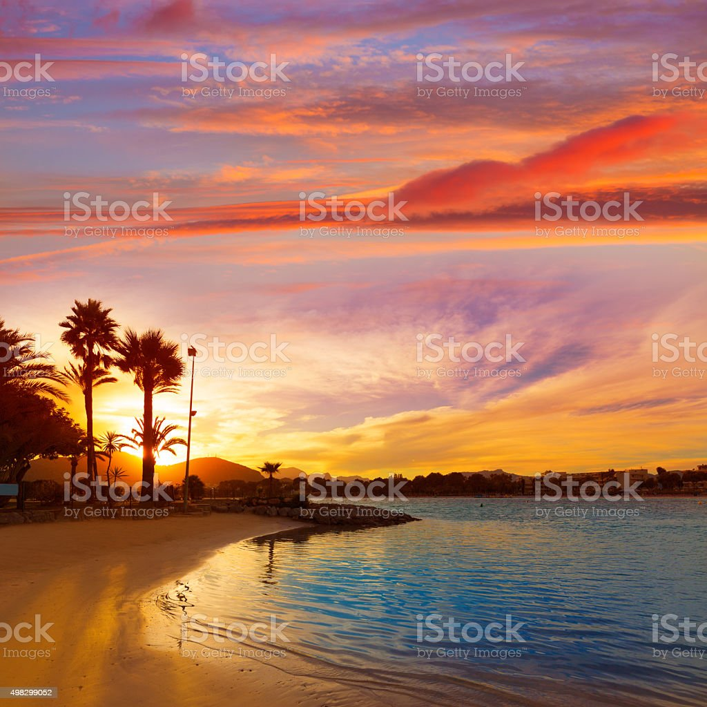 Alcudia Majorca at sunset on the beach Mallorca stock photo