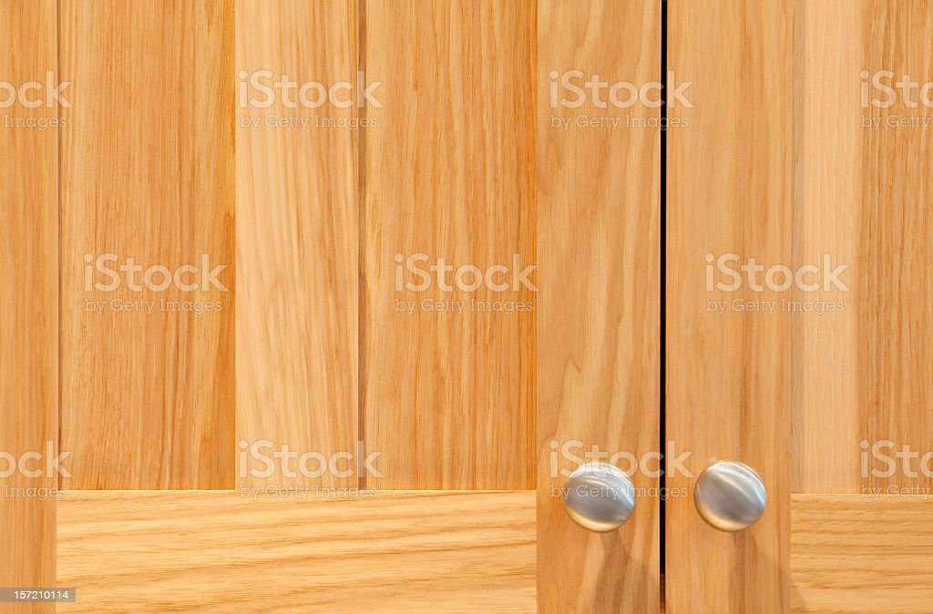 Alder Wood Cabinets With Stainless Steel Knobs stock photo