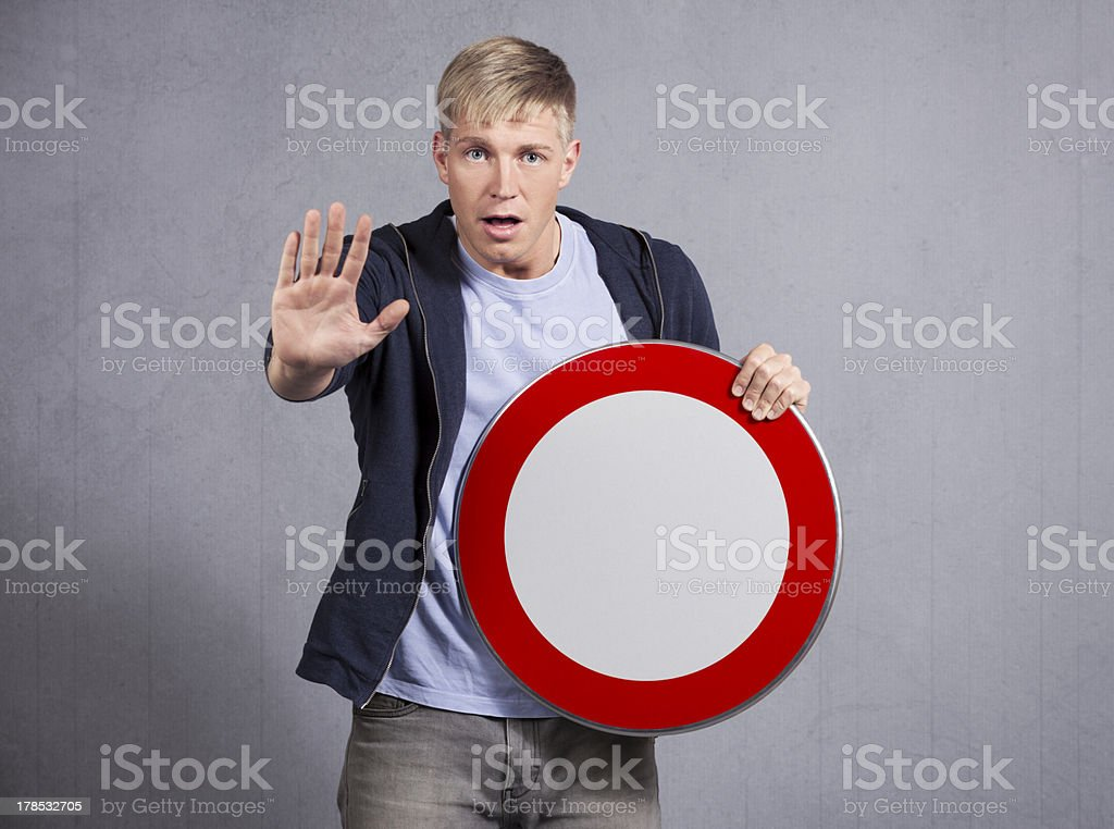 Alert man showing universal forbidden indicator. royalty-free stock photo