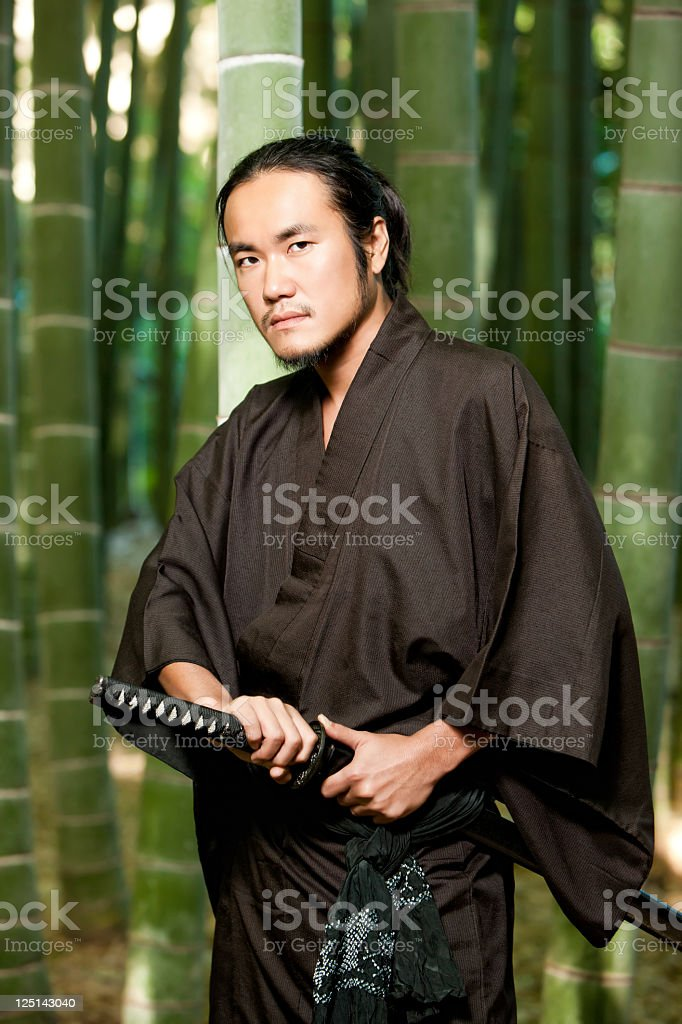 Alert Samauri Warrior in Bamboo Forest stock photo