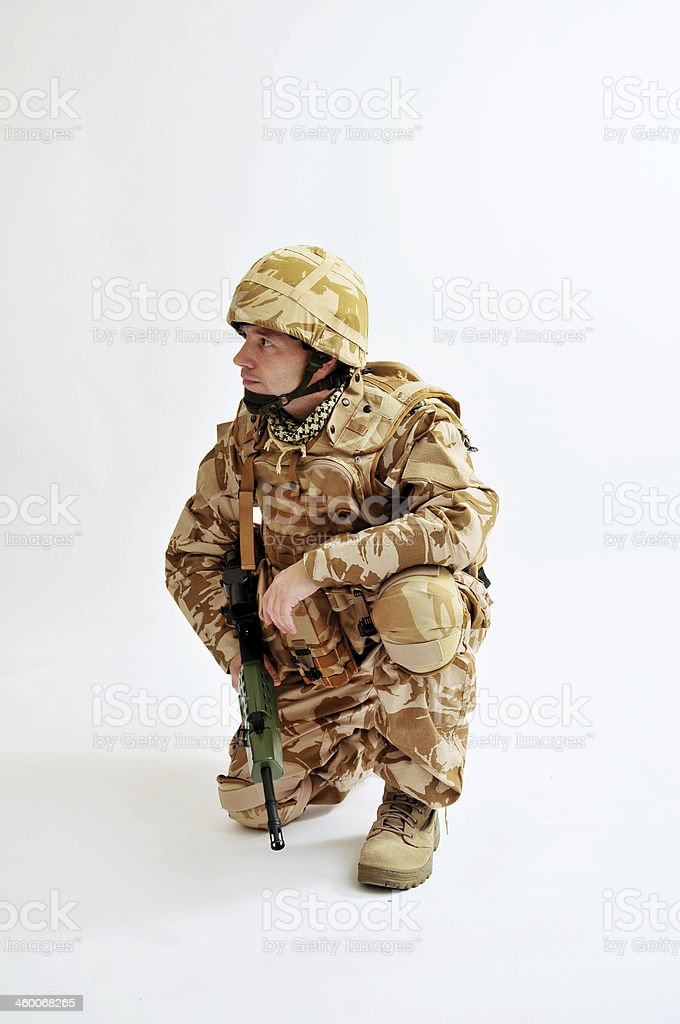 Alert Soldier Kneeling stock photo