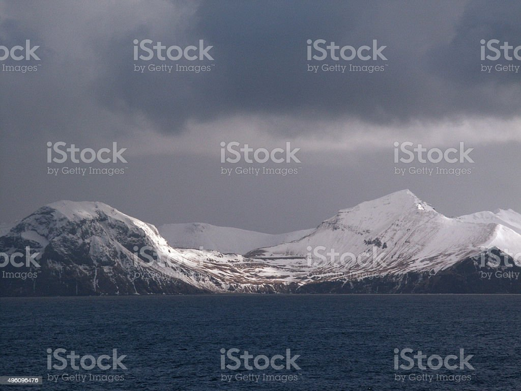 Aleutian Islands and Snow Covered Mountains stock photo