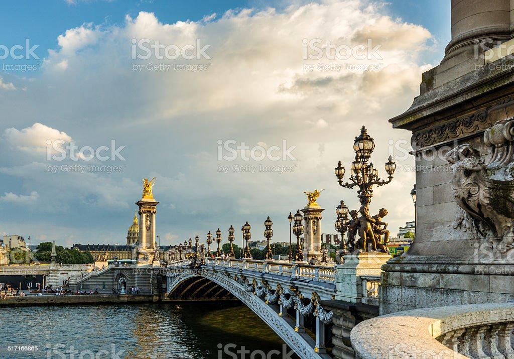 Alexandre III bridge (Pont Alexandre III) during dramatic sunset stock photo