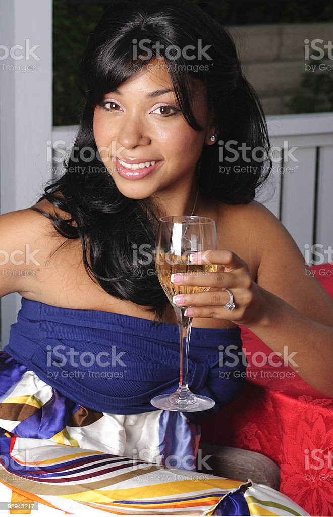 Alexis holding glass of wine stock photo