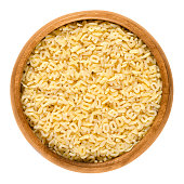 Alfabeto, alphabet pasta in wooden bowl over white