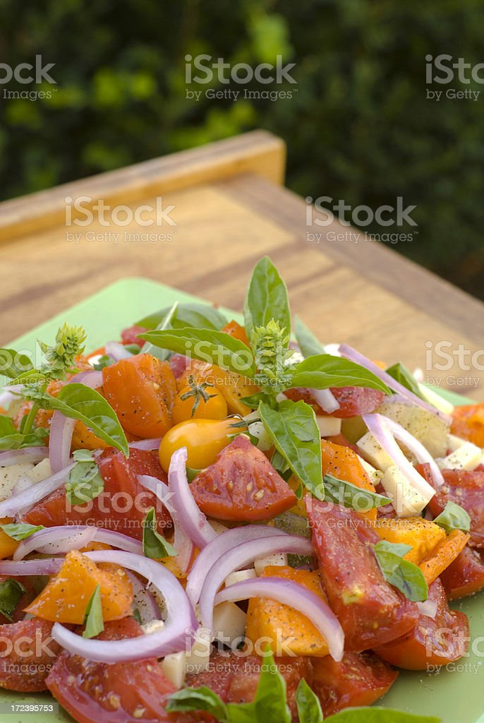 Alfresco Heirloom Tomato and Basil Salad royalty-free stock photo