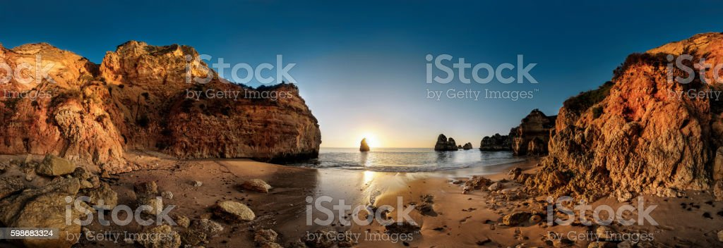 Algarve Beach with huge rocks during sunset stock photo