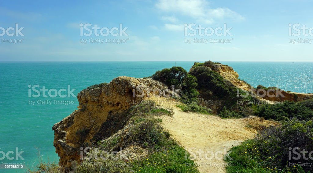 algarve coast near faro stock photo