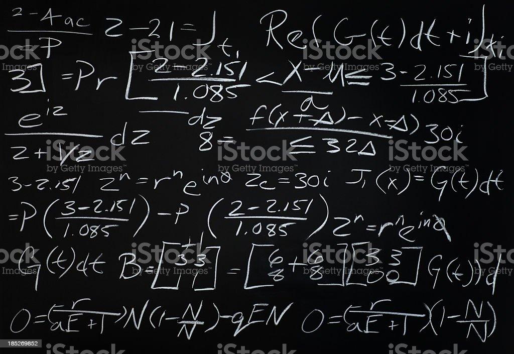 Algebra Math Problem on a Black Chalkboard stock photo