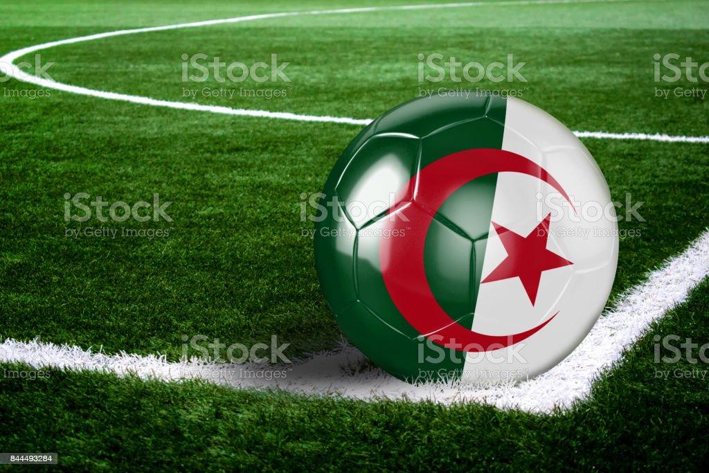 Algeria Soccer Ball on Field at Night stock photo