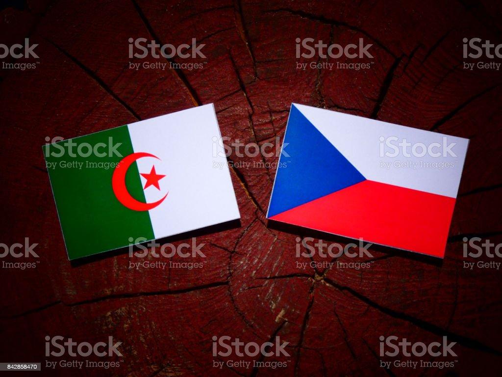 Algerian flag with Czech flag on a tree stump isolated stock photo