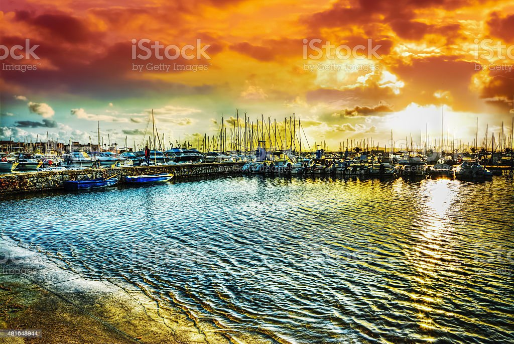 Alghero harbor under a dramatic sky stock photo