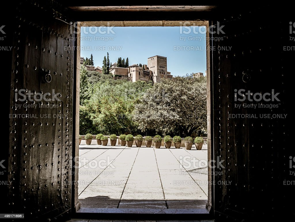 Alhambra framed by large wooden doors stock photo