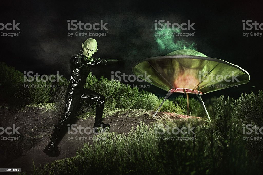 Alien and UFO Spaceship Landing stock photo
