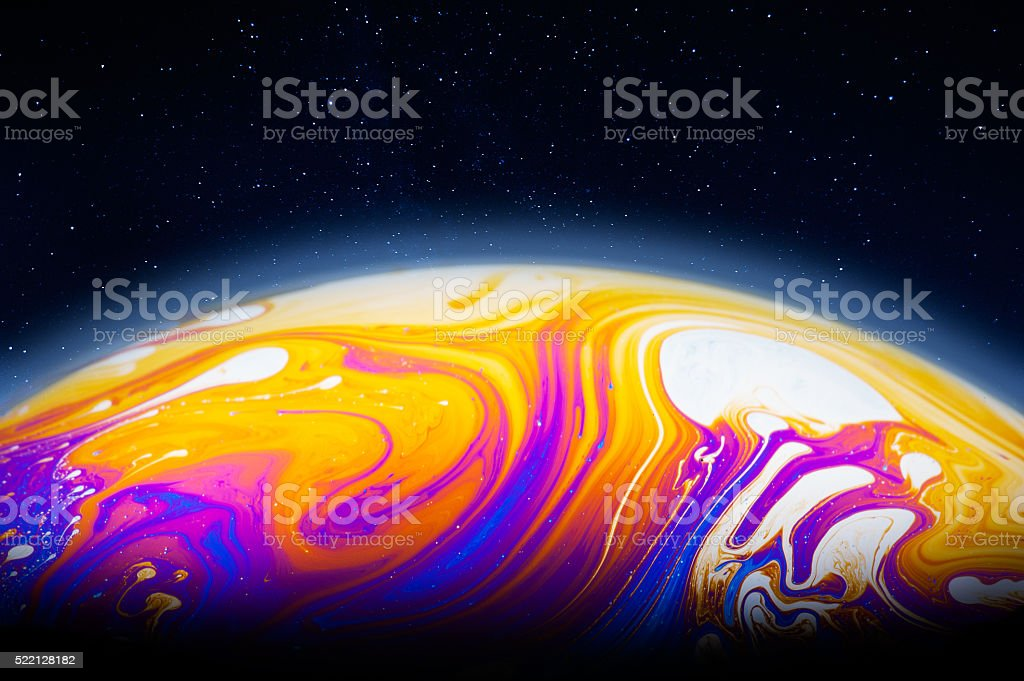 Alien planet in the cosmos, colorful soap bubble film stock photo