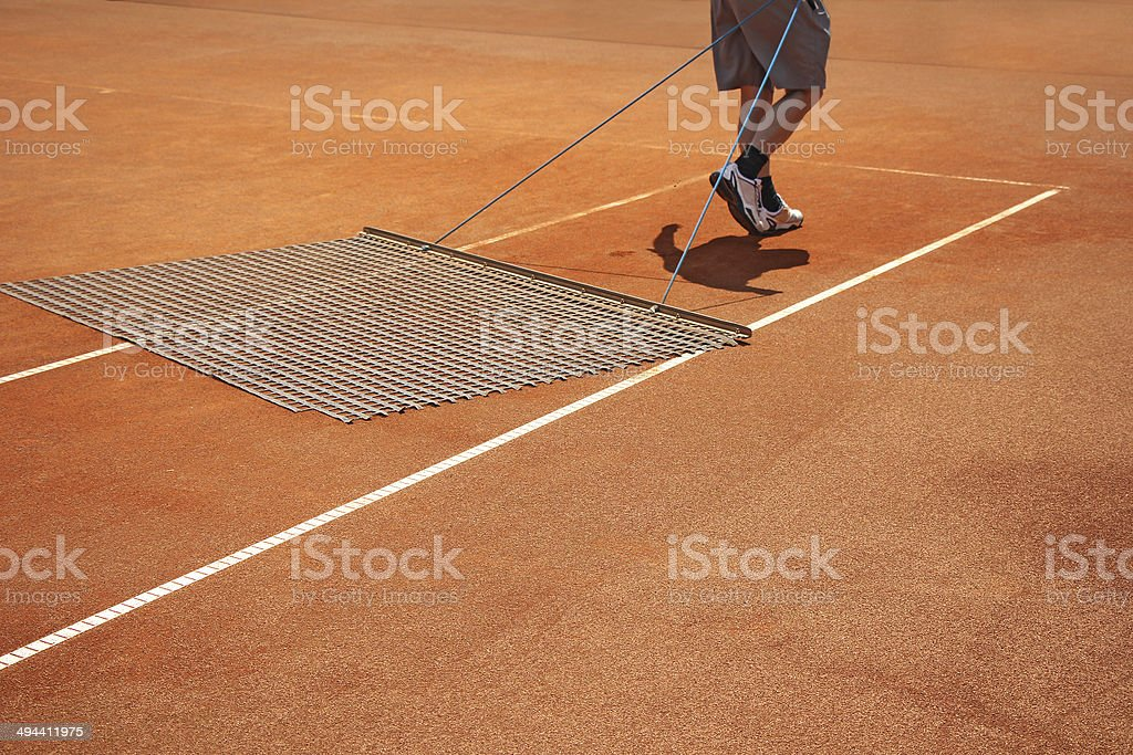 Aligning tennis court stock photo