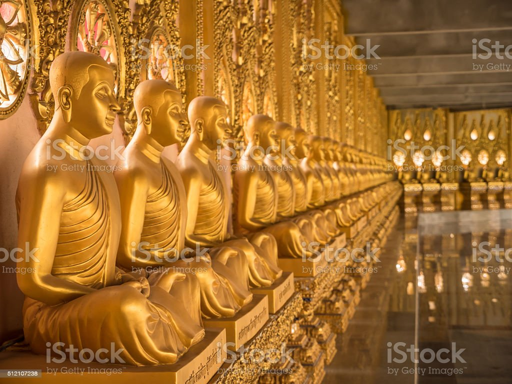 Alignment of Buddhas statues. stock photo