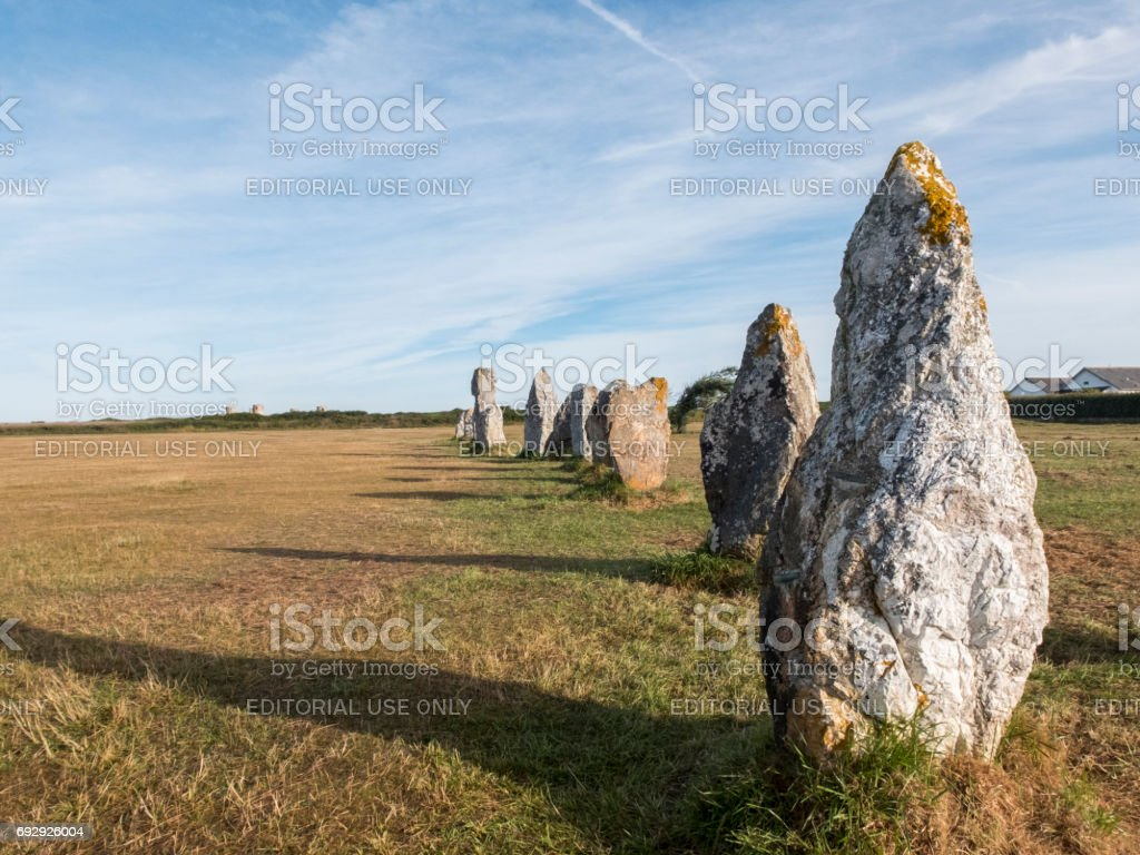 Alignment of megaliths on broad grass. stock photo