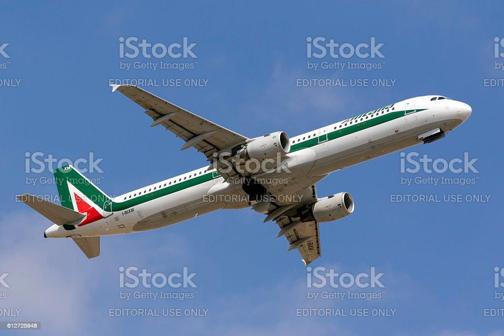 Alitalia A321 climbing after take off stock photo