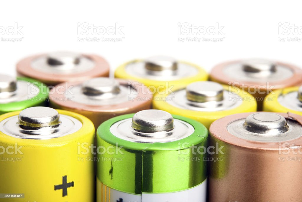 alkaline batteries isolated on white background royalty-free stock photo