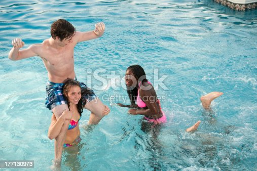 All american diverse friends play chicken in swimming pool for Chicken in swimming pool